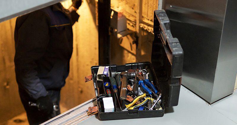 Elevator tech in elevator shaft